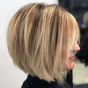 Discover layered bob haircuts for women over 50 with fine hair